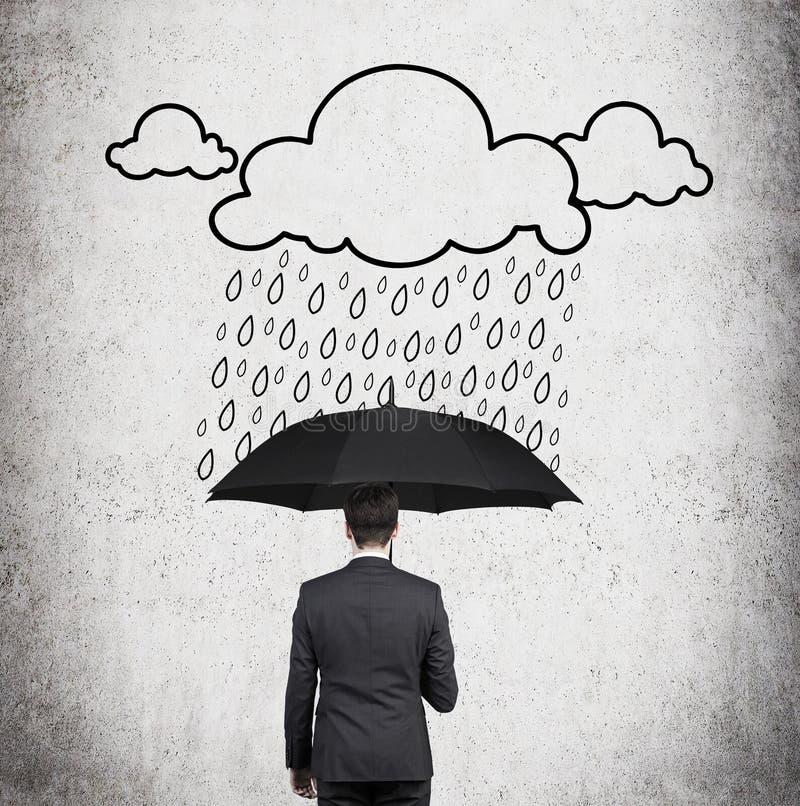 Zakenman en tekeningsregen stock foto