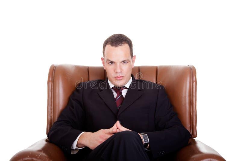 Zakenman gezet op een stoel stock foto