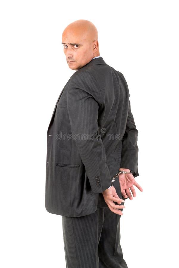 Zakenman in handcuffs stock foto