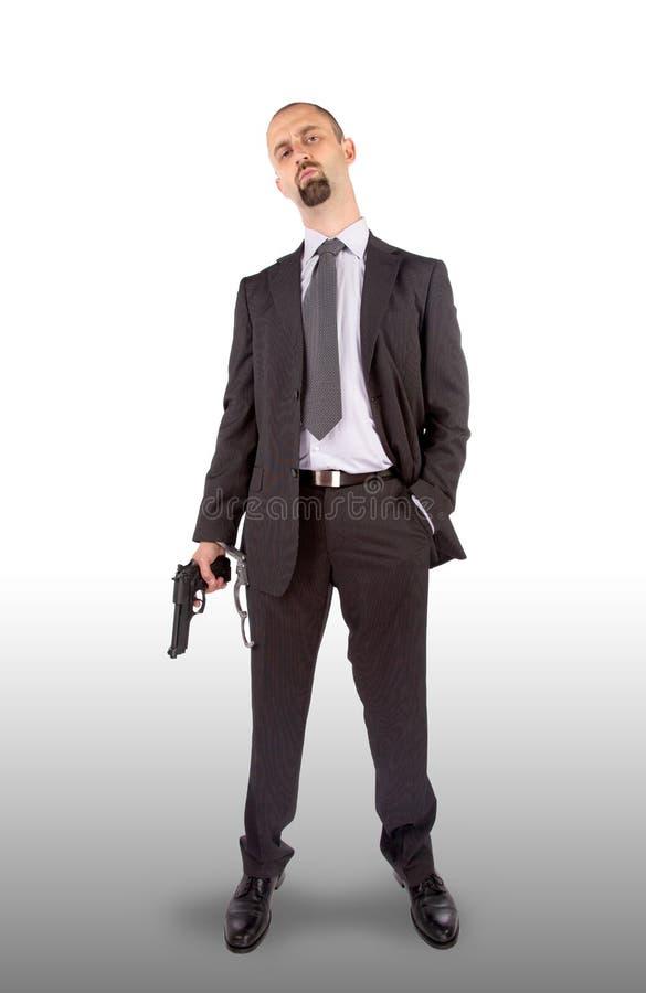 Zakenman in handcuffs met in hand pistool royalty-vrije stock foto's