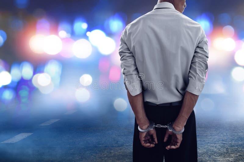 Zakenman in handcuffs op de straat royalty-vrije stock afbeeldingen