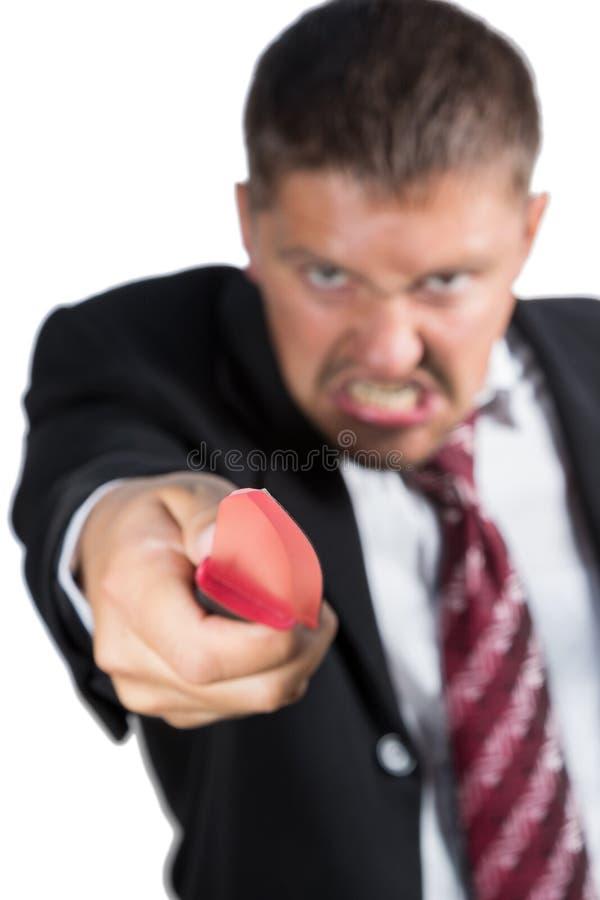 Zakenman het aanvallen met een mes stock afbeeldingen