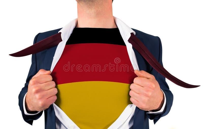Zakenman het openen overhemd om de vlag van Duitsland te openbaren royalty-vrije stock fotografie