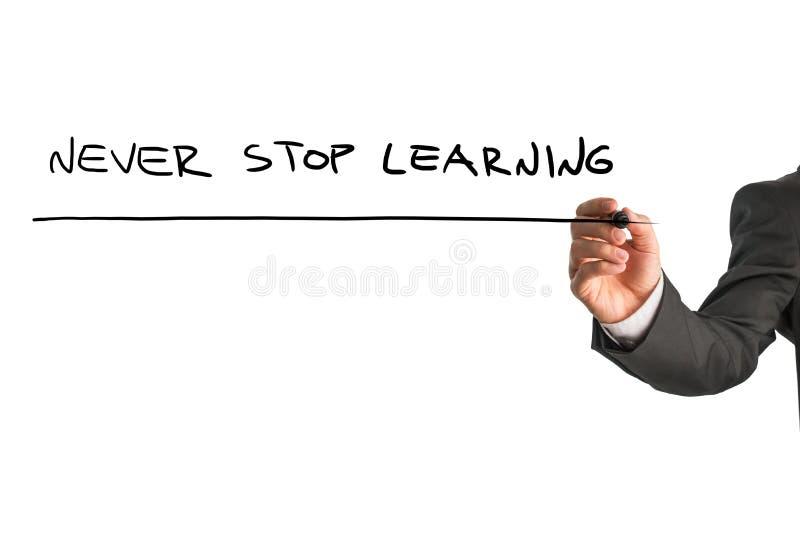 Zakenman het schrijven - houd nooit op lerend stock foto