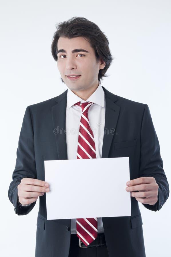 Zakenman holdind een lege advertentie stock afbeelding