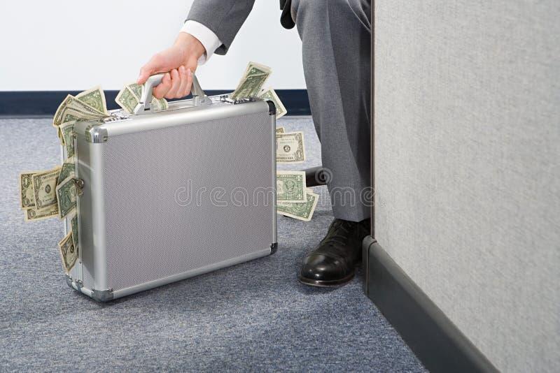 Zakenman Holding Briefcase stock foto's