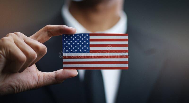 Zakenman Holding Card van de Vlag van de Verenigde Staten van Amerika stock afbeeldingen