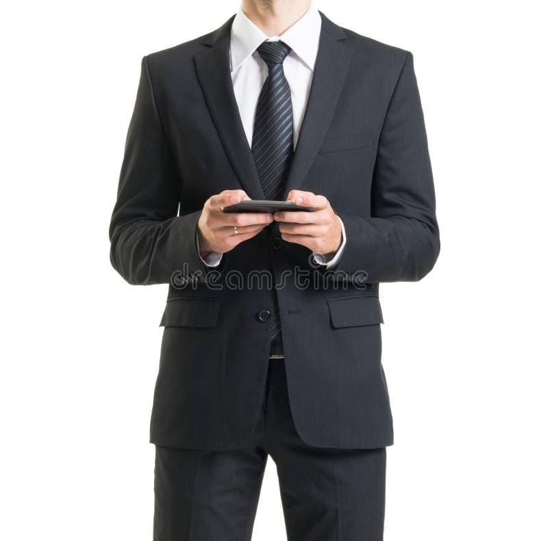 Zakenman in kostuum op wit wordt geïsoleerd dat Close-up van de mens in formalwear stock afbeelding