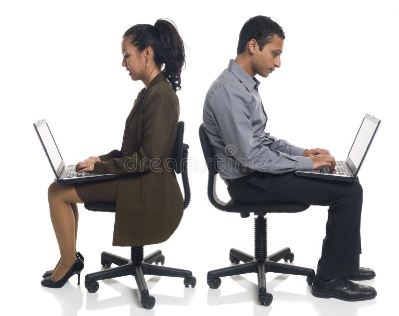 Zakenman - laptop stoel stock foto