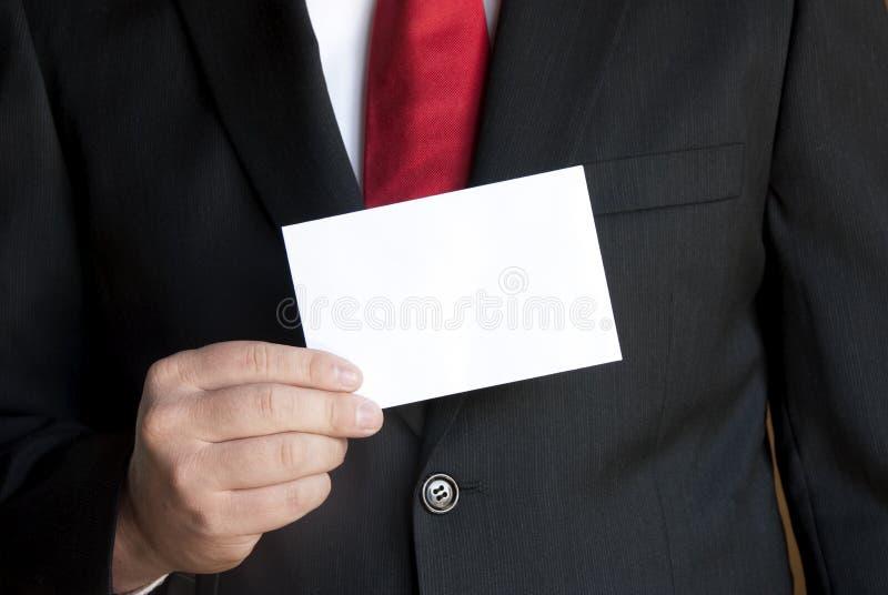 Zakenman met adreskaartje stock foto