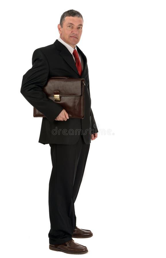 Zakenman met aktentas op witte achtergrond wordt geïsoleerd die stock foto