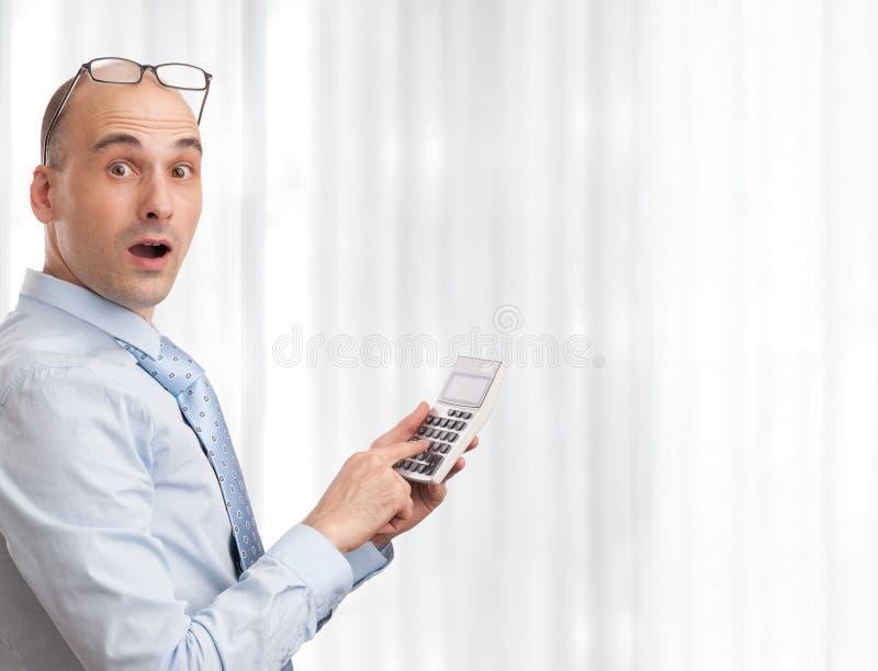 Zakenman met calculator stock fotografie