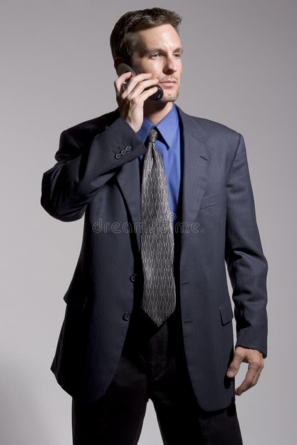 Zakenman met Cellulaire telefoon stock afbeeldingen