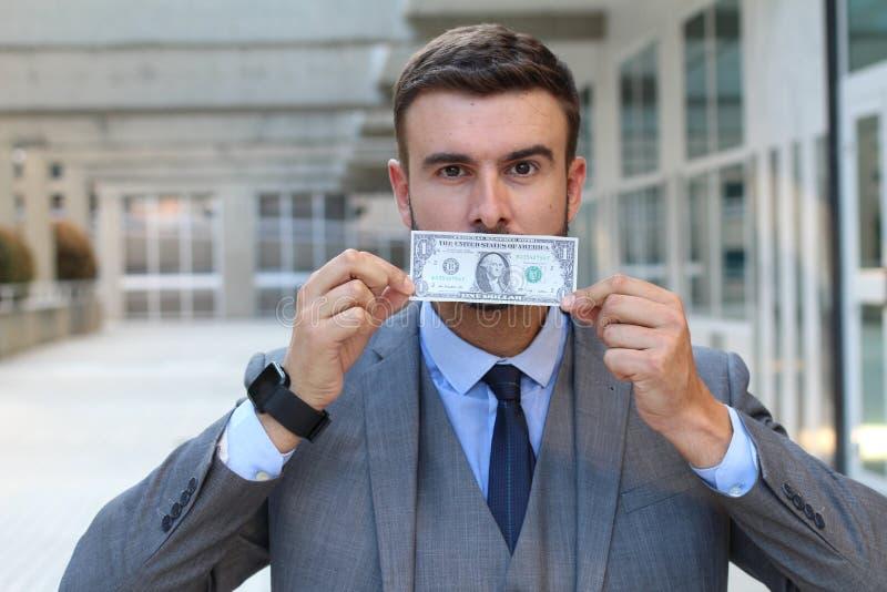 Zakenman met dollarrekening die mond behandelen stock afbeeldingen