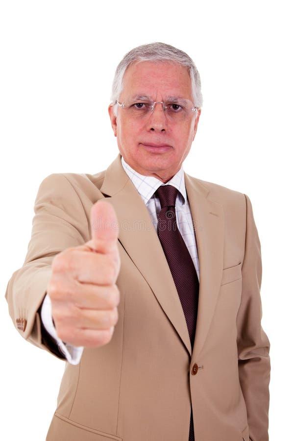 Zakenman met duim die als teken van succes wordt opgeheven stock fotografie
