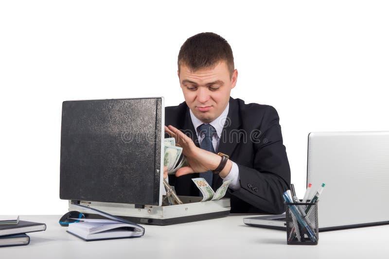 Zakenman met een aktentashoogtepunt van geld in de handen op witte achtergrond worden geïsoleerd die royalty-vrije stock foto