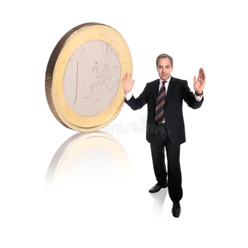 Zakenman met een muntstuk stock foto's