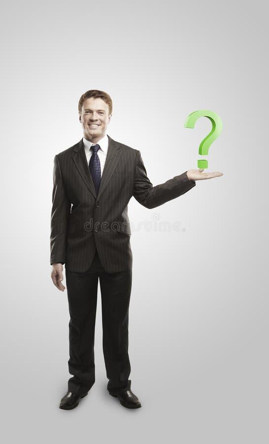 Zakenman met een vraagteken op zijn hand royalty-vrije stock afbeeldingen