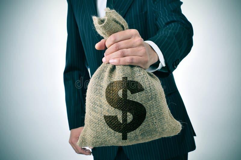 Zakenman met een zak van het jutegeld royalty-vrije stock afbeelding