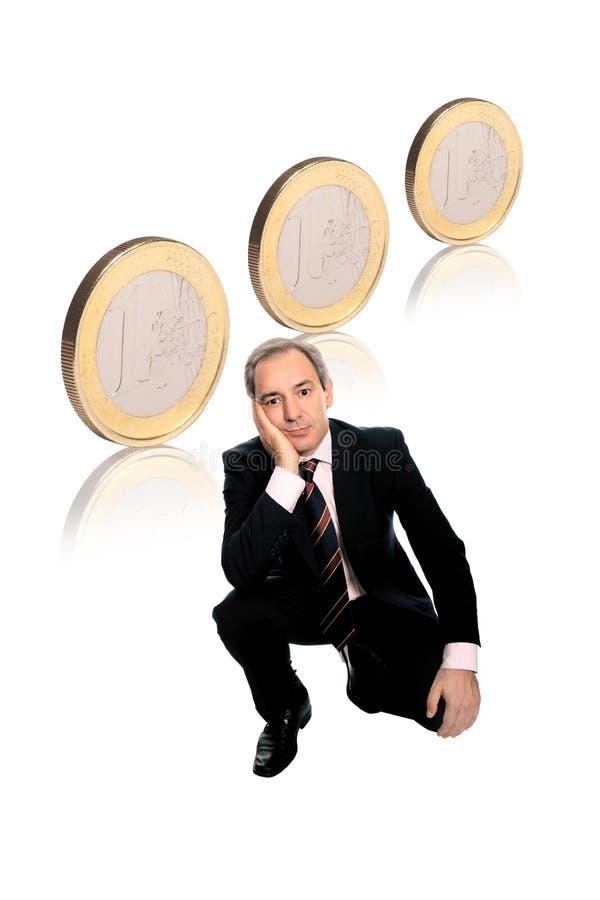 Zakenman met euro muntstukken stock afbeeldingen