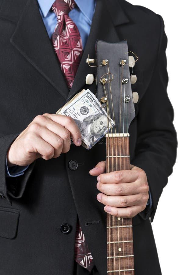 Zakenman met gitaar en geld royalty-vrije stock fotografie