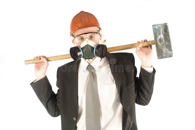 Zakenman met hamer stock foto