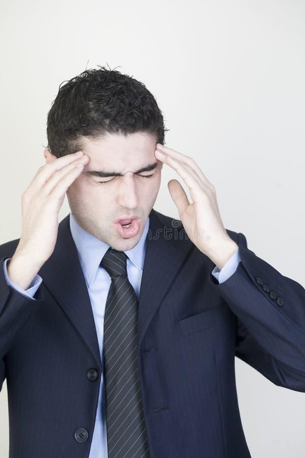 Zakenman met hoofdpijn stock foto