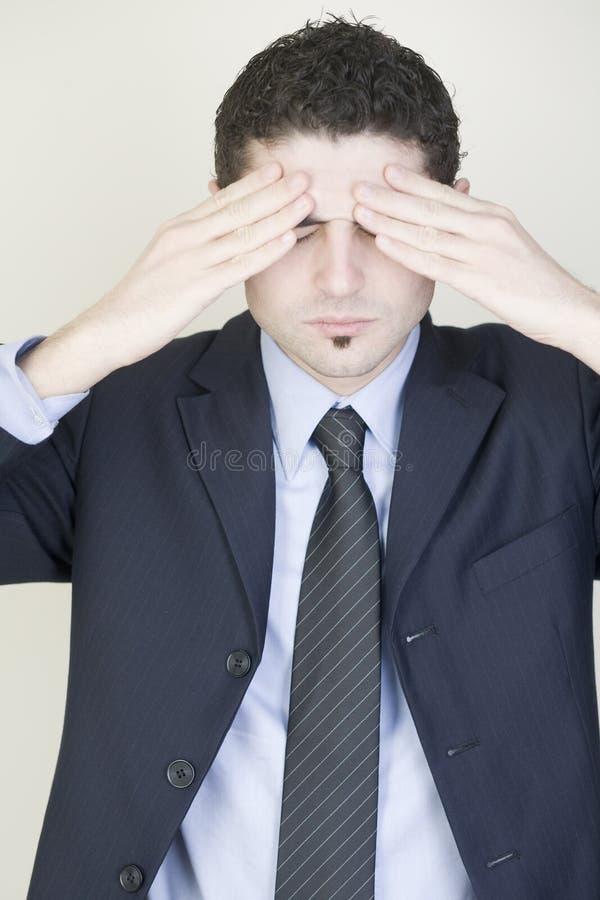 Zakenman met hoofdpijn stock foto's