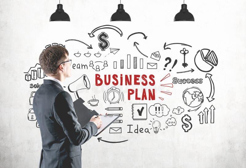 Zakenman met klembord, businessplan royalty-vrije stock foto