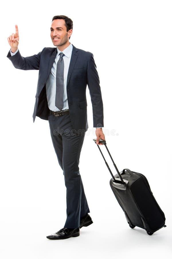 Zakenman met koffer die een taxi tegenhouden royalty-vrije stock afbeelding
