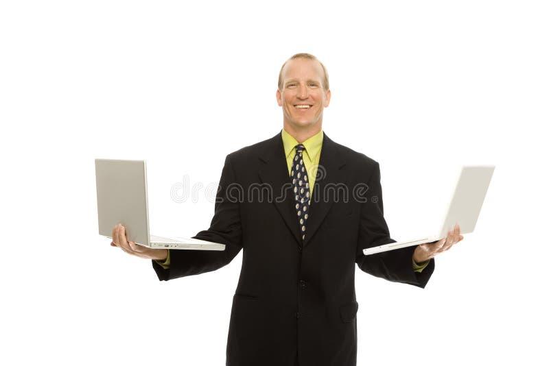 Zakenman met laptops royalty-vrije stock foto