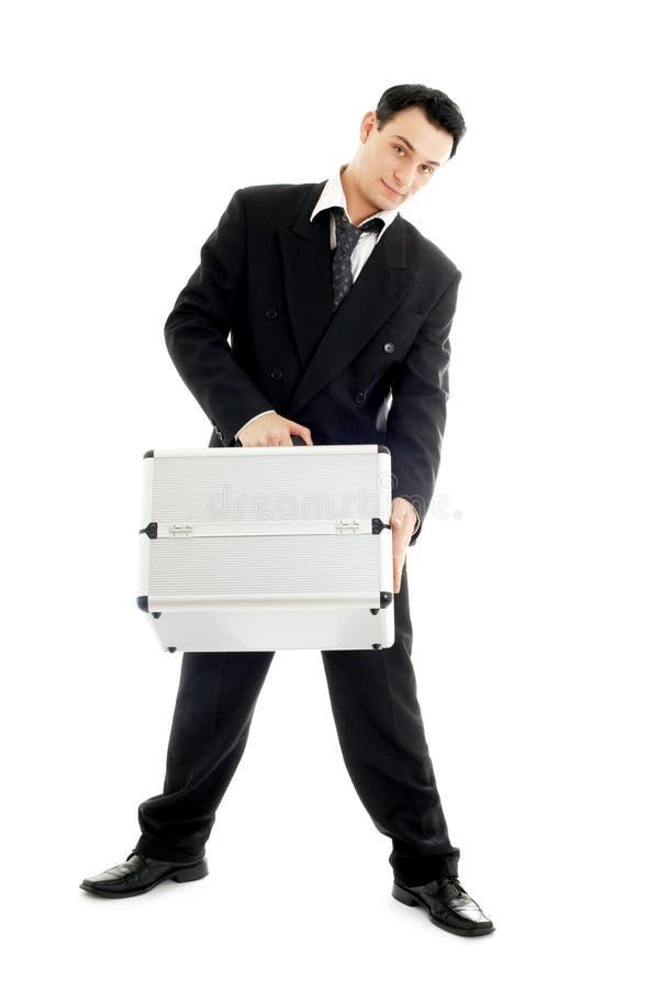 Zakenman met metaalcontainer stock foto