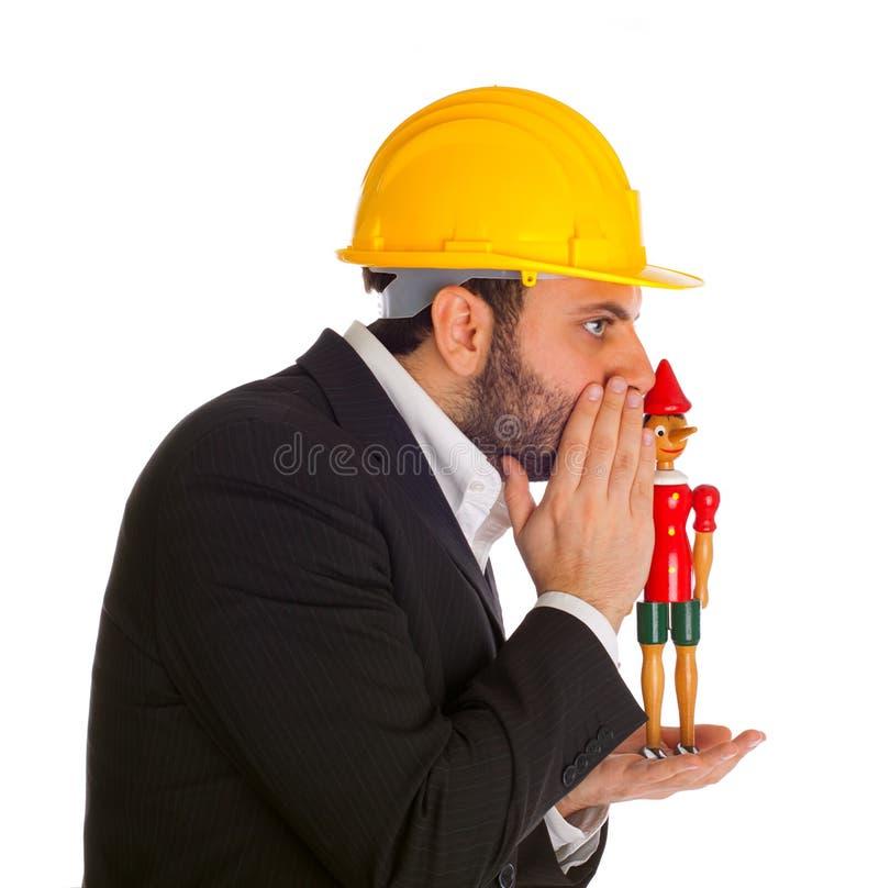 Zakenman met Pinocchio stock afbeelding