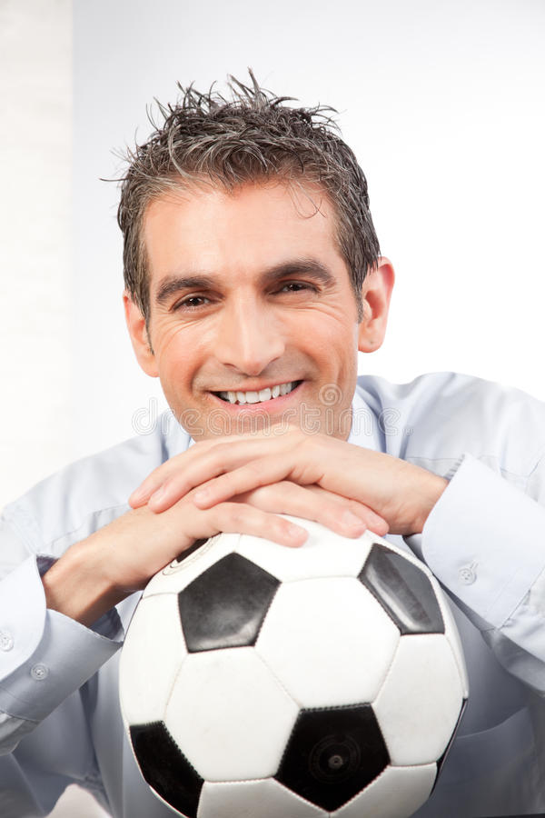 Zakenman met Voetbal op het Werk stock afbeeldingen