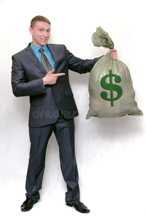 Zakenman met zakhoogtepunt van geld Gelukkige winnaar royalty-vrije stock foto
