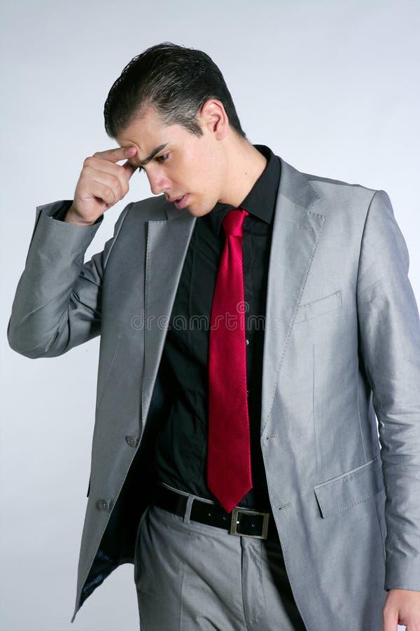 Zakenman ongerust gemaakte beklemtoond en droevige hoofdpijn stock afbeeldingen