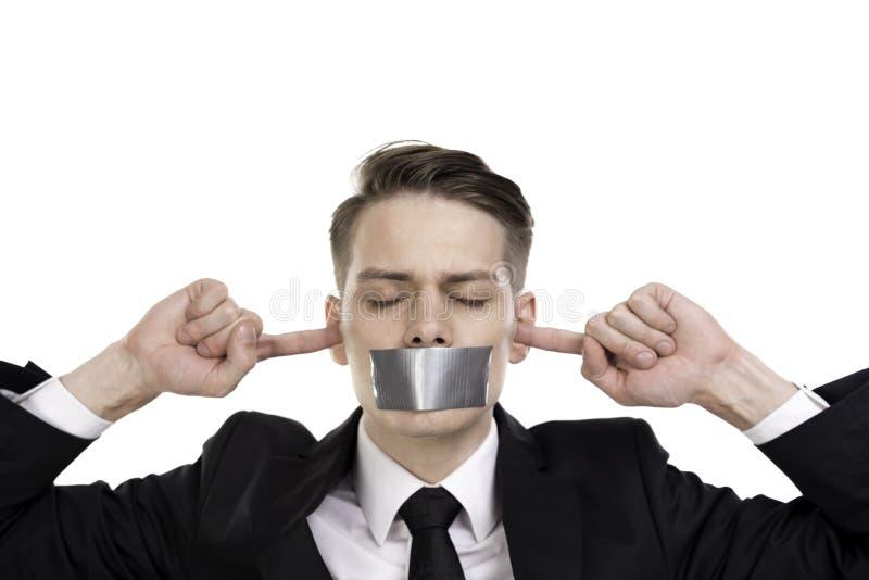 Zakenman in reeks met gesloten ogen, oren en band over zijn mond stock foto