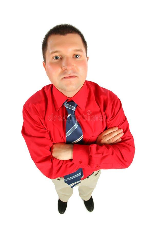 Zakenman in rood overhemd met zijn gekruiste handen, royalty-vrije stock fotografie