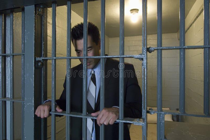 Zakenman Standing Behind Bars royalty-vrije stock foto
