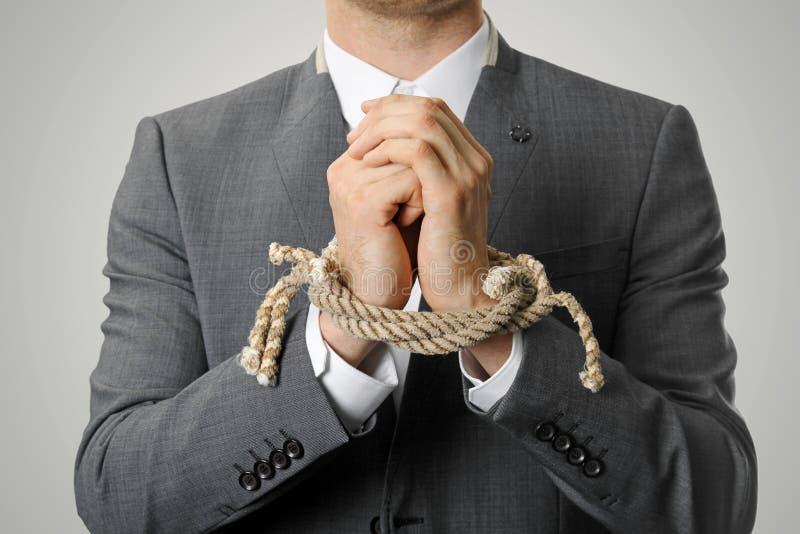 Zakenman With Tied Hands stock afbeelding