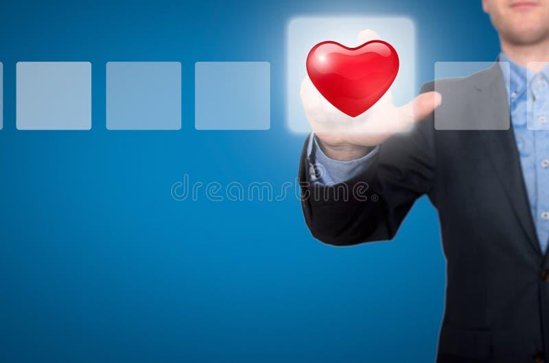 Zakenman Touching Heart Button en Tikkende Controledoos royalty-vrije stock foto