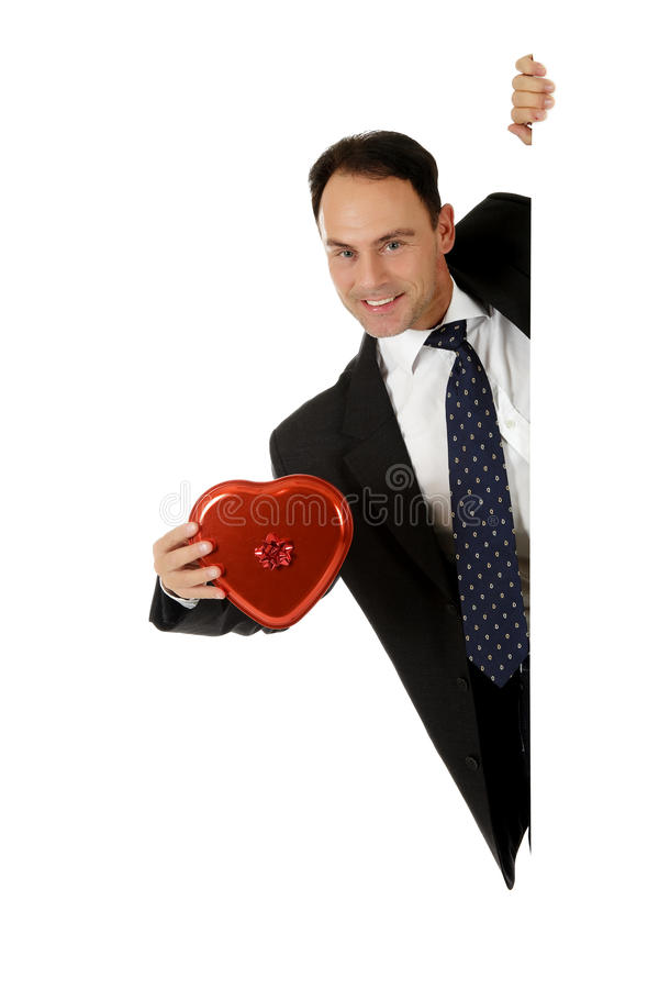 Zakenman, valentijnskaartchocolade royalty-vrije stock afbeelding