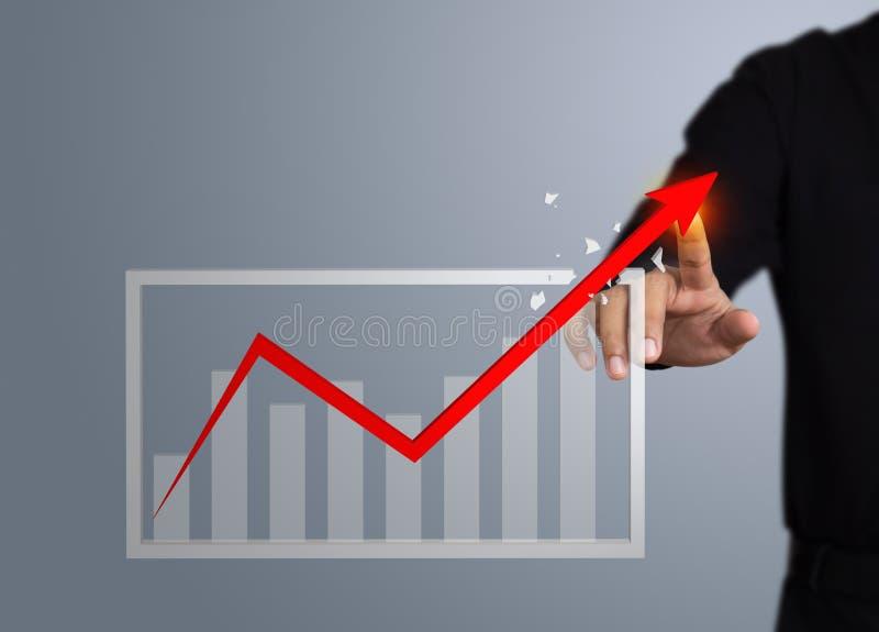 Zakenman wat betreft een de groeipijl royalty-vrije stock afbeeldingen