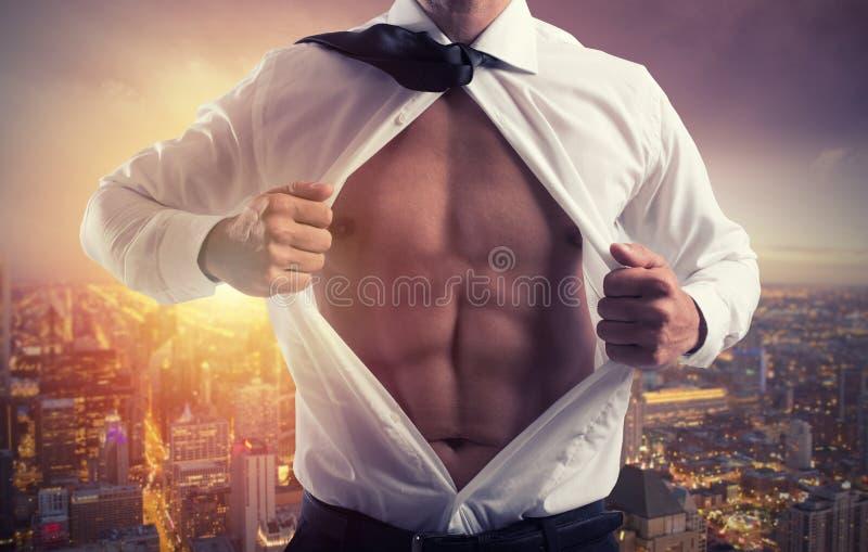 Zakenman zoals een super held Concept bepaling en succes stock afbeelding