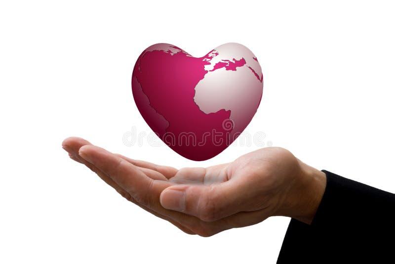 Zakenmanhand en het roze aardehart royalty-vrije stock afbeelding