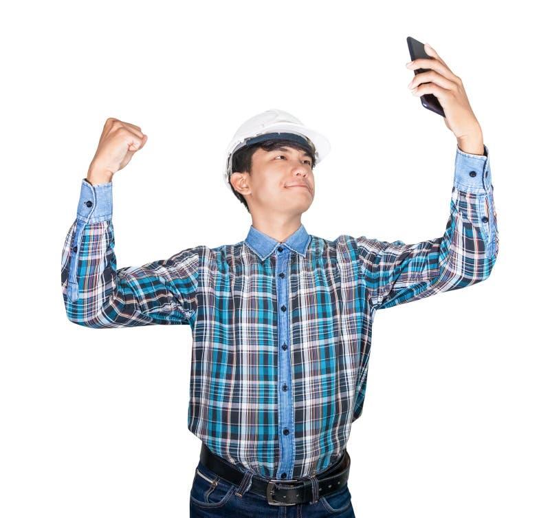 Zakenmaningenieur het denken bevel met celtelefoon met 5g-netwerk, hoge snelheid mobiel Internet en helm van de slijtage de witte stock foto's