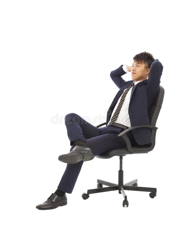 Zakenmanzitting op een stoel en het denken strategieën royalty-vrije stock foto's