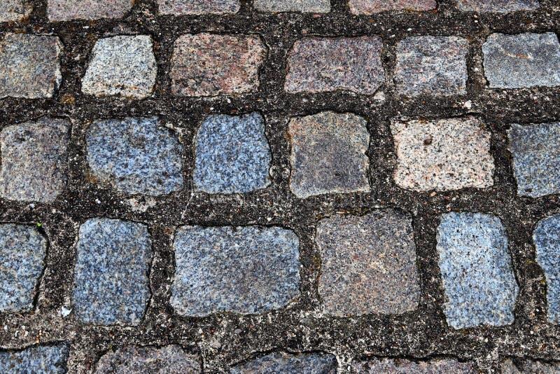 Zakończenie w górę widoku inne perspektywy na brukowiec ziemi powierzchniach brać na północnych Germany ulicach zdjęcia stock
