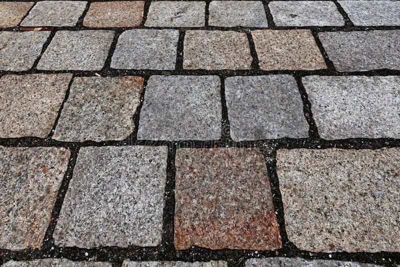 Zakończenie w górę widoku inne perspektywy na brukowiec ziemi powierzchniach brać na północnych Germany ulicach obraz royalty free