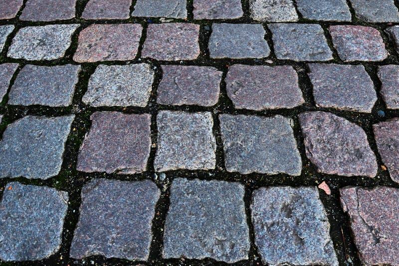 Zakończenie w górę widoku inne perspektywy na brukowiec ziemi powierzchniach brać na północnych Germany ulicach zdjęcie royalty free